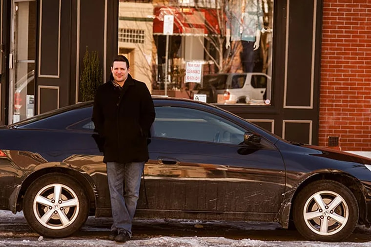 Nick Elmi, chef/owner of Laurel, winner of the most recent season of Top Chef, leans on his car on East Passyunk Avenue on Monday, February 17, 2014.  ( Matthew Hall / Staff Photographer )