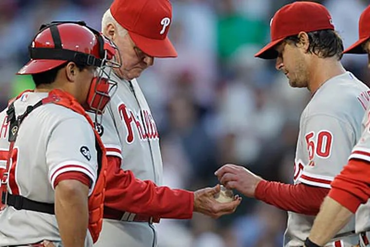 Jamie Moyer allowed nine earned runs on nine hits while recording only three outs. (AP Photo/Charles Krupa)