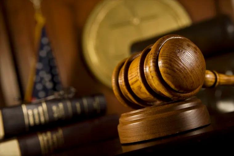 Closeup of gavel in court room.