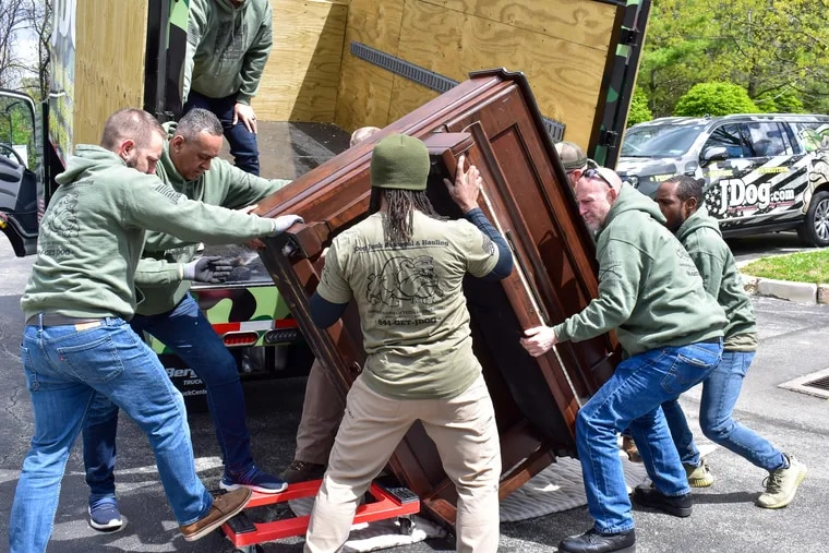 """In an episode of """"Operation Hidden Treasures,""""  a goup of workers at JDog Junk Removal and Haulings receive training at JDog University on the proper way to remove heavy items -- in this case a piano."""