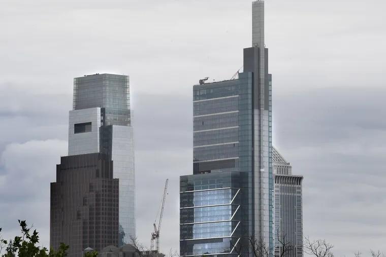 Comcast Center, left, and Comcast Technology Center, rise above the center city skyline in Philadelphia in June.