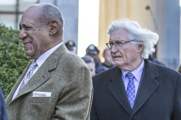 Bill Cosby leaves the Montgomery County Courthouse, followed by his attorney Thomas Mesereau after a pre-trial hearing for his second trial on sexual assault.