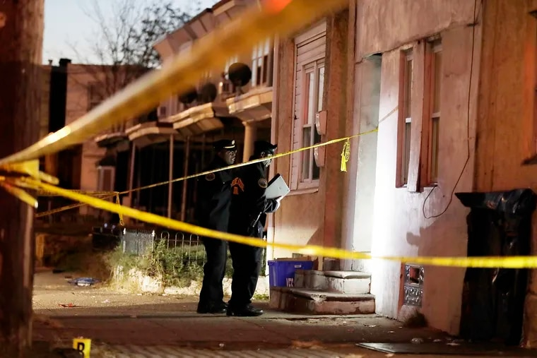 Police investigate the scene where a 10-year-old boy was shot on Nov. 6, 2019.