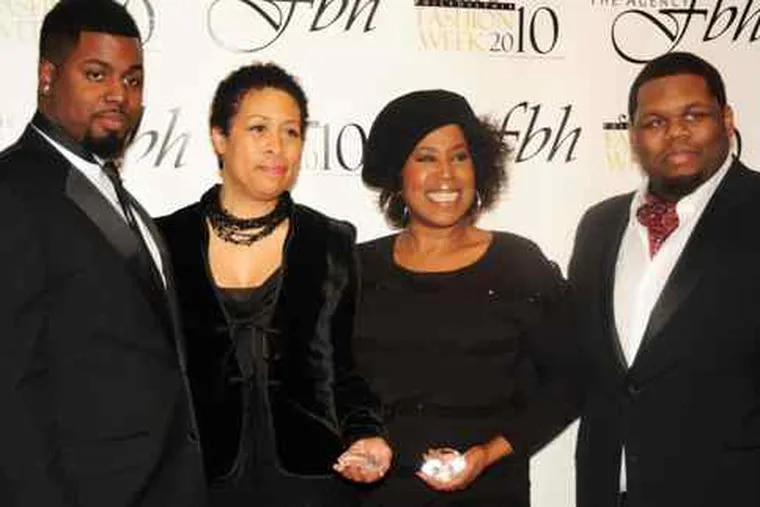 Philadelphia Fashion Week's opening-night party draws (from left) founder Kevin Parker, Julia Wilch-Jeffers, mother of rapper Eve; consultant Cheryl Ann Wadlington; and founder Kerry Scott. The event was held Thursday at the Banana Republic store in Center City.