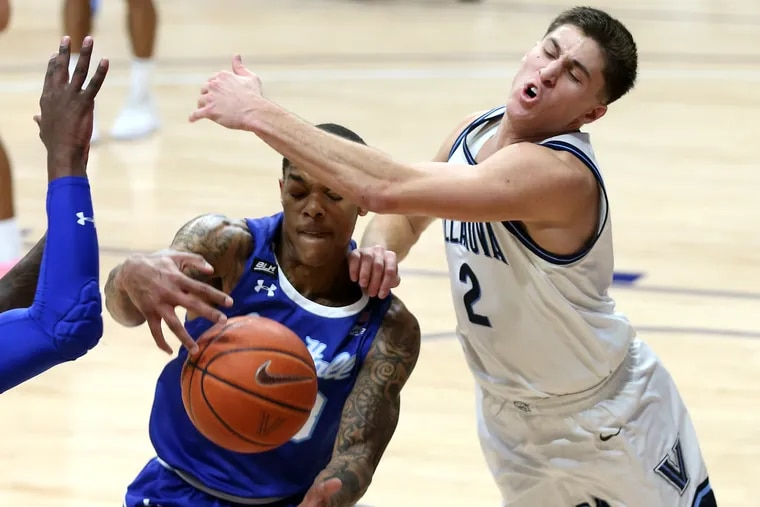 Collin Gillespie (right)  of Villanova and Shavar Reynold of Seton Hall go after a loose ball in their game on Jan. 19, 2021, at Finneran Pavilion.