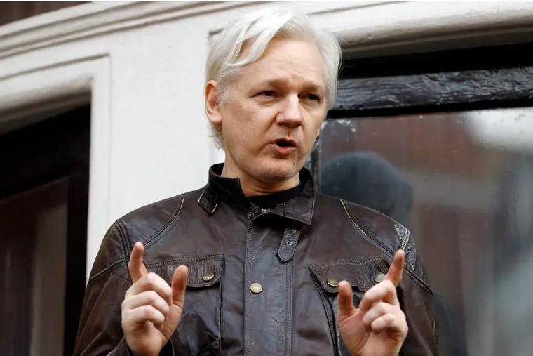FILE - In this May 19, 2017 file photo, WikiLeaks founder Julian Assange gestures to supporters outside the Ecuadorian embassy in London, where he has been in self imposed exile since 2012.