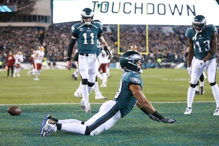 Eagles wide receiver Golden Tate celebrates his first-quarter touchdown with quarterback Carson Wentz and wide receiver Nelson Agholor against Washington.