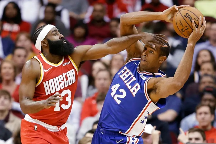 Philadelphia 76ers center Al Horford (42) looks to pass the ball as Houston Rockets guard James Harden defends during the first half of an NBA basketball game Friday, Jan. 3, 2020, in Houston.