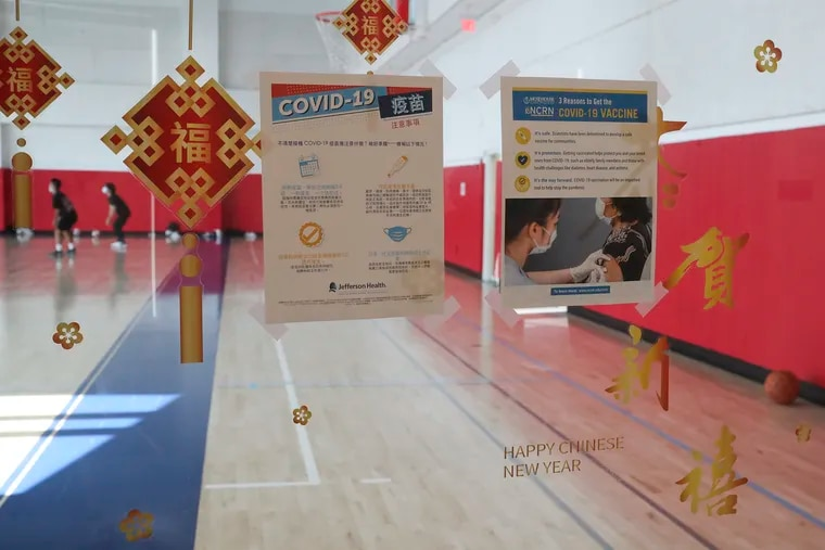 Signs promoting the COVID-19 vaccine hang outside of the gym at the Crane Community Center in Philadelphia on Tuesday, July 27, 2021.