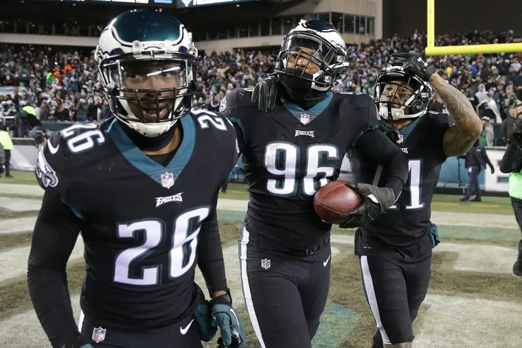 Eagles defensive end Derek Barnett (96) celebrates after scoring on a fumble at the end of the Raiders game to make the final score 19-10. With Barnett is Jaylen Watkins (26) and Ronald Darby.