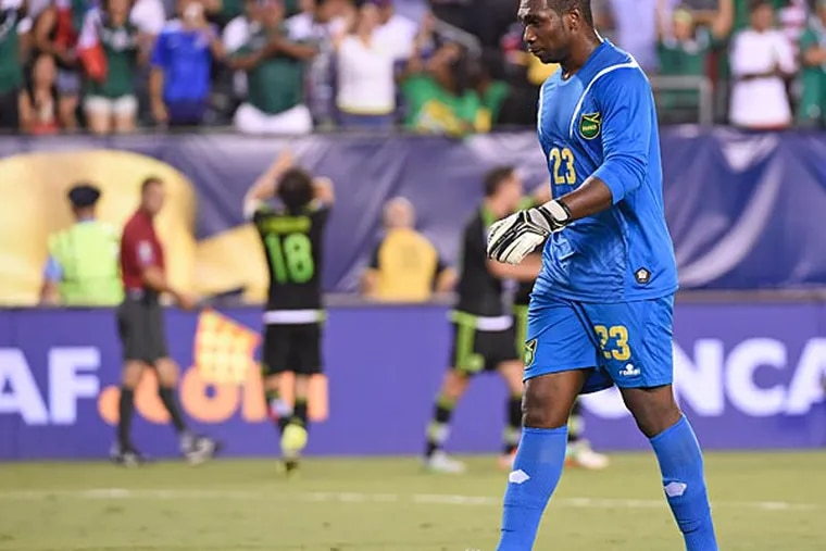 Jamaica goalkeeper Ryan Thompson (23) walks back the goal after allowing goal to Mexico midfielder Andrés Guardado (18) during a CONCACAF Gold Cup final match at Lincoln Financial Field. (Eric Hartline/USA Today)