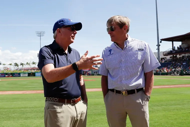 Phillies president Andy MacPhail (left) has one year left on his contract. If he remains in his position in 2021, it could complicate managing John Middleton's attempt to restructure the leadership of the baseball operations department.