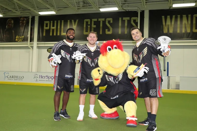 Philadelphia Wings players Trevor Baptiste, Matt Rambo and Chris Cloutier (from left to right), with mascot Wingston.