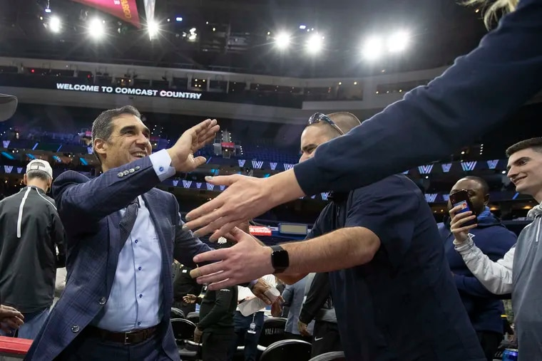 Jay Wright shaking hands with fans after Villanova's win over Georgetown at the Wells Fargo Center in January.