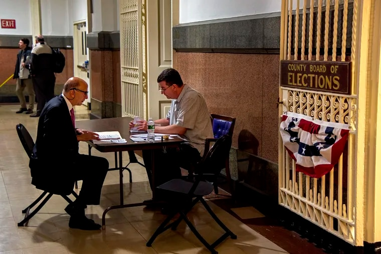City Councilman Mark Squilla (left) checks in with Board of Elections administrator Joe Lynch on Tuesday, March 12, 2019, as the deadline looms for candidates to file petitions to get on the May 21 primary ballot.