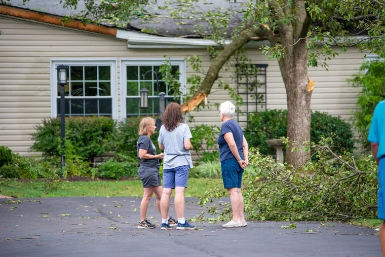 People view the damage at a home in Franconia Township, Montgomery County, on Thursday. The National Weather Service has confirmed that a tornado had touched down. An official said that 18 to 20 homes were damaged.