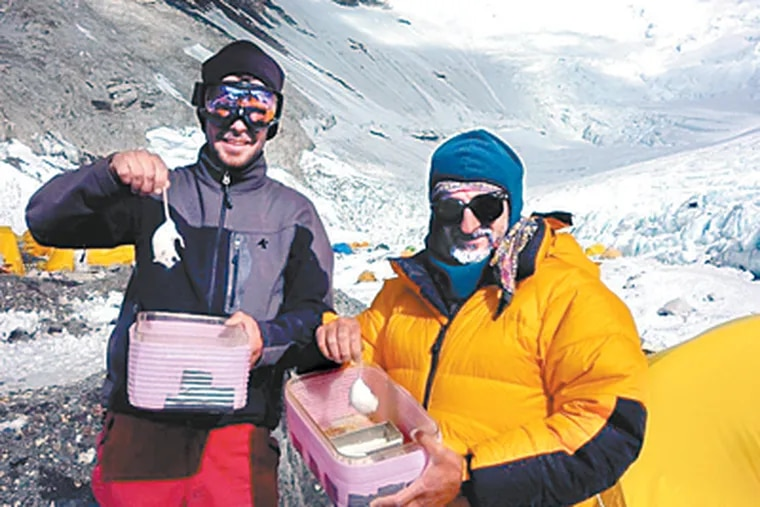 Tejvir Khurana (right), and Gabriel Willmann, (right), physiologists at the University of Pennsylvania, on the slopes leading to Mount Everest with their mice.