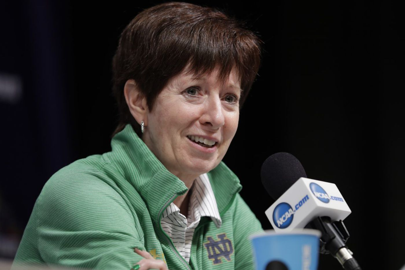 Coach Muffet McGraw, a St. Joseph's graduate, guides Notre Dame to a stunning upset of Connecticut and a berth in the NCAA final