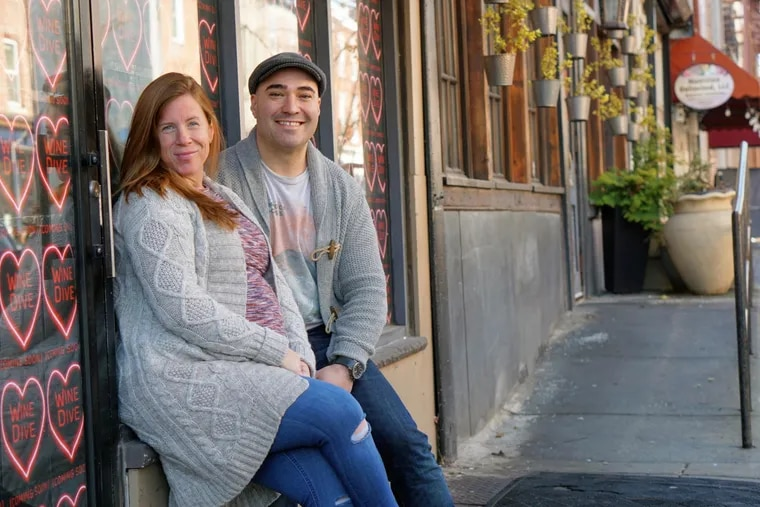 Heather Annechiarico and Chris Fetfatzes outside Wine Dive at 1506 South St., next to their bar-restaurant The Cambridge.