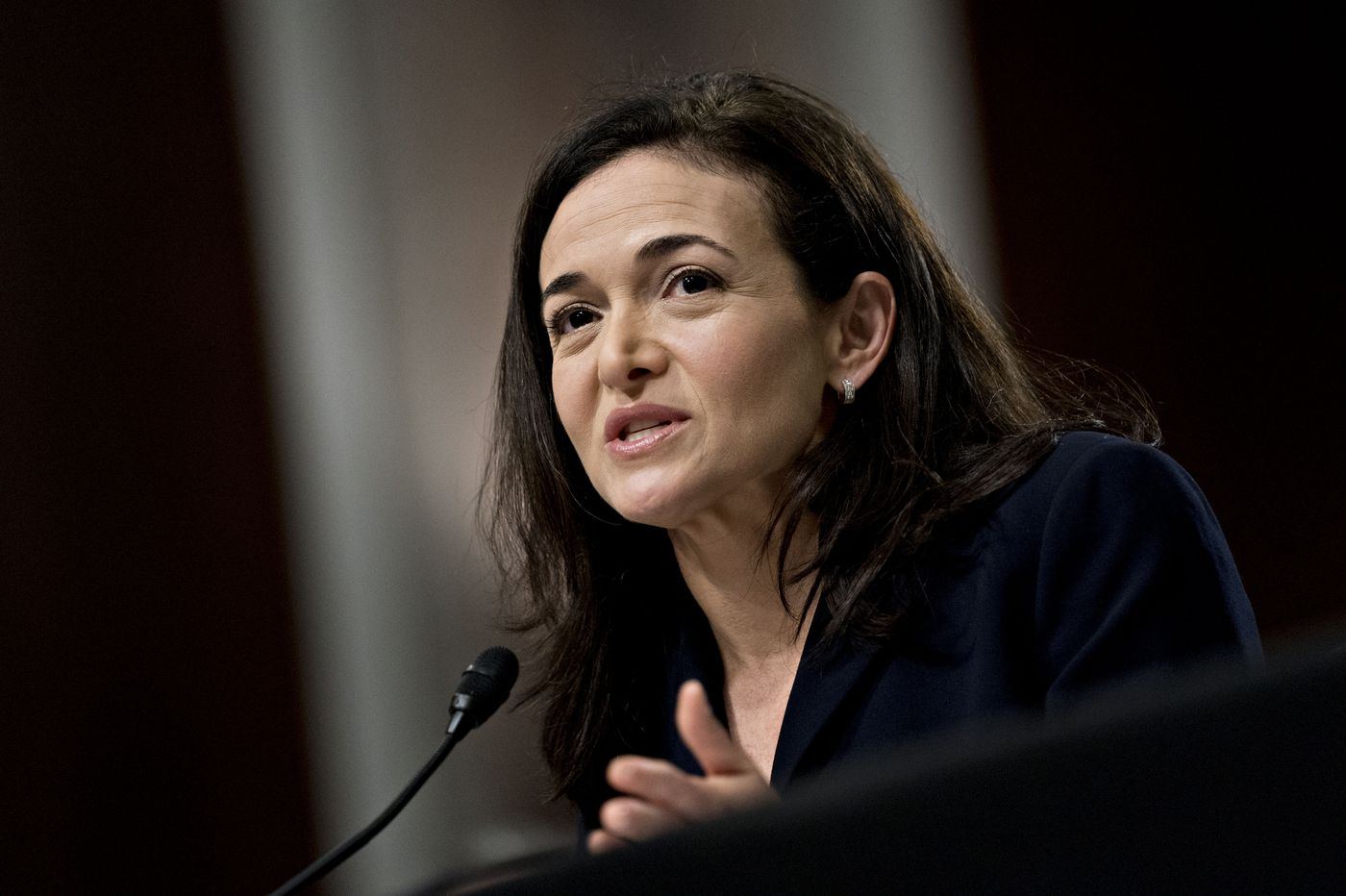 In a reversal, Facebook's Sandberg says she heard about hiring of political consultancy