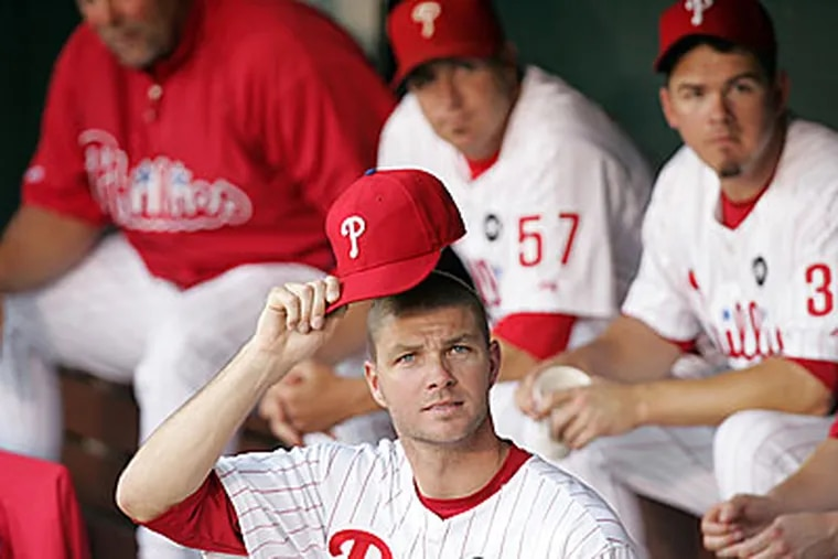 In the bullpen at game time pitcher Ryan Madson tips his hat at the camera set up in the corner. ( David Swanson / Staff Photographer )