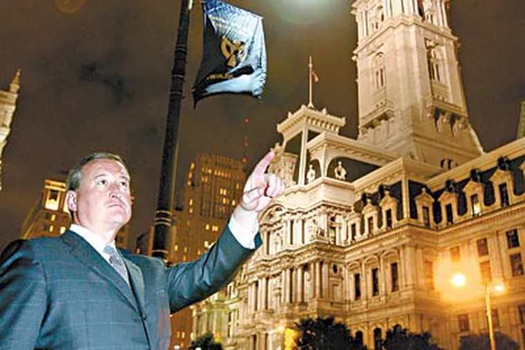 City Councilman James Kenney is among those in favor of replacing the yellowish streetlights with LEDs, such as this one near City Hall. (CHARLES FOX / Staff Photographer)
