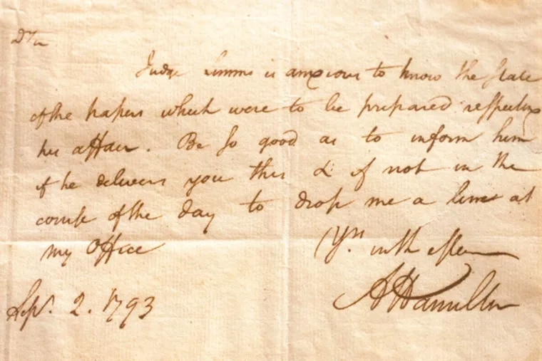 A letter from Alexander Hamilton to William Rawle, dated Sept. 2, 1793 displayed in a conference room at the law firm of Rawle & Henderson Chestnut St., Philadelphia. ( DAVID M WARREN / Staff Photographer )