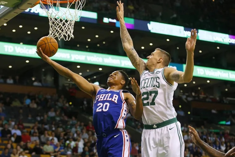 Markelle Fultz goes to the basket past the Celtics' Daniel Theis (27) during the first quarter Monday.