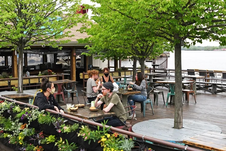 Staffers at Morgan's Pier test a new seating arrangement with added space for social distancing as the massive beer garden prepares for the possibility of outdoor dining being allowed.