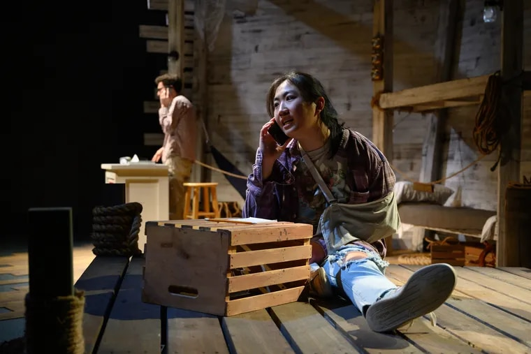 Michael A. Stahler (rear left) and Annie Fang in Azuka Theatre's production of SHIP.