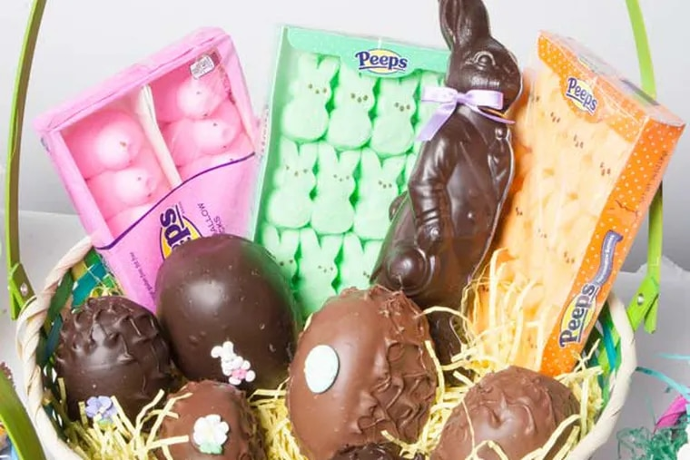 An Easter basket loaded up with chocolate eggs, Peeps, and other candies that are the area's best. ( Jessica Griffin / Daily News Staff )
