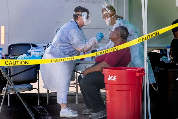 Obesity rates have continued to climb during the pandemic. In this photo from July 2020, volunteers provide coronavirus testing at a parking lot next to Providence Rehabilitation & Healthcare Center on Mercy Fitzgerald Campus in Yeadon.