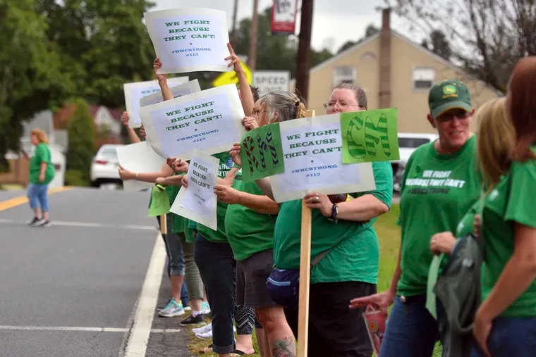Family members of White Haven Center residents line Church Road to rally against the closing of the facility, Thursday, Sept. 12, 2019 in White Haven, Pa.