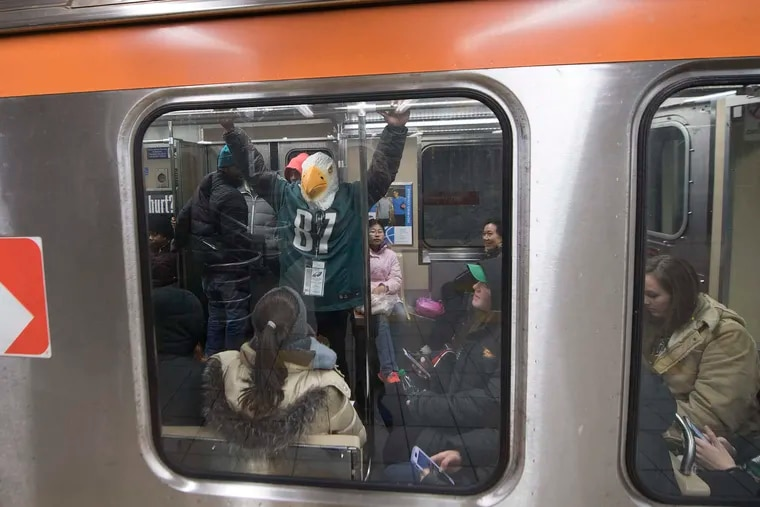 Eagles fans board SEPTA trains returning home after the Eagles Super Bowl Victory parade in 2018.