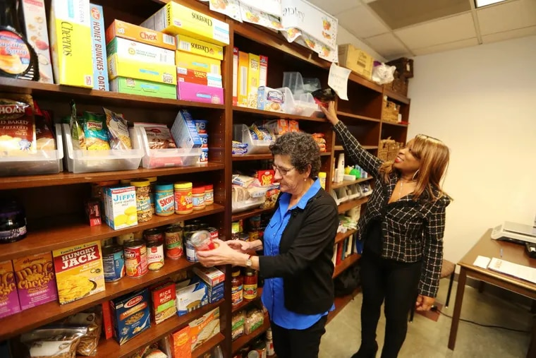 Rutgers-Camden Student Health Services Director Neuza Maria Serra (L) and operations coordinator Madrid Moore at the food pantry at Rutgers-Camden on Wednesday, November 22, 2017.