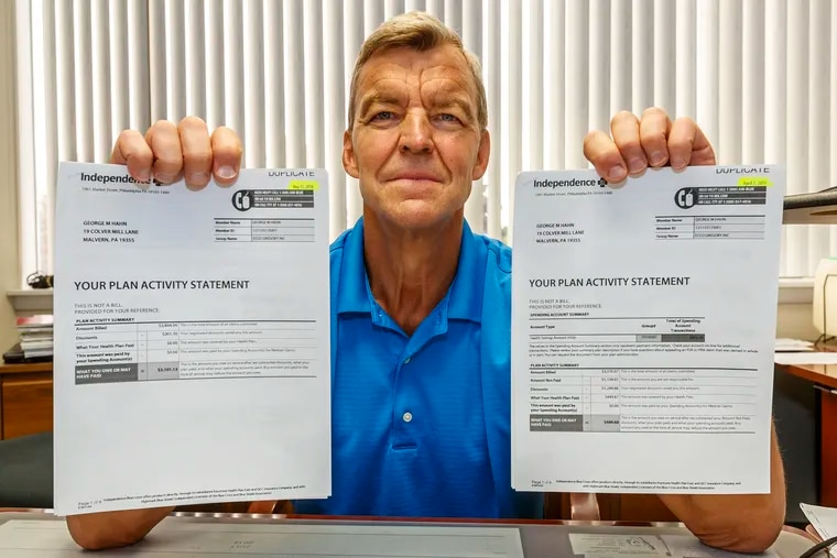 George Hahn holds the two bills from his health care providers, one for $339.44 and the other for $3,101.13, for two identical echocardiograms a year a part – both at Paoli Hospital. The cheaper one was done by a cardiology group, the second was considered a hospital procedure.