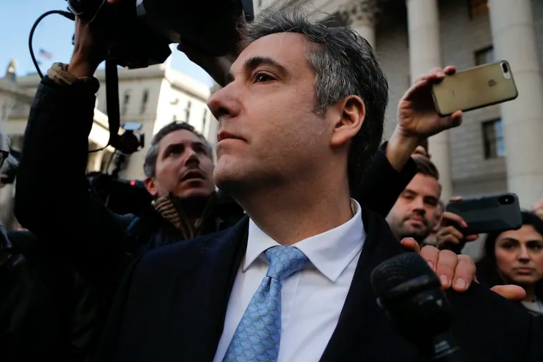 Michael Cohen walks out of federal court, Thursday, Nov. 29, 2018, in New York, after pleading guilty to lying to Congress about work he did on an aborted project to build a Trump Tower in Russia. (AP Photo/Julie Jacobson)
