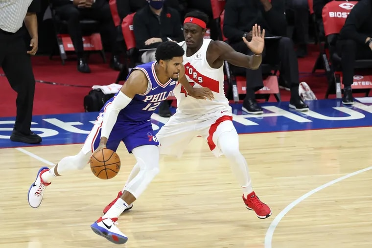 Tobias Harris (left) drives against Toronto's Pascal Siakam on Tuesday night. Harris filled the role of the Sixers' No. 2 scorer very well.