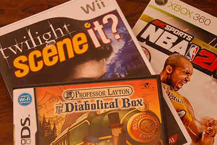 """Here are just a few of the amazingly diverse, perfect-gift video games available this shopping season, appealing to (clockwise, from top left) """"Twilight"""" trivia buffs, sports freaks and bright kids. (Bob Laramie / Staff Photographer)"""