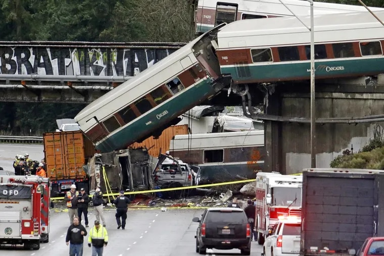 Cars from Amtrak Train 501 spill onto Interstate 5 in DuPont, Wash. Seventy-seven passengers and five crew members were aboard when the train derailed Monday.