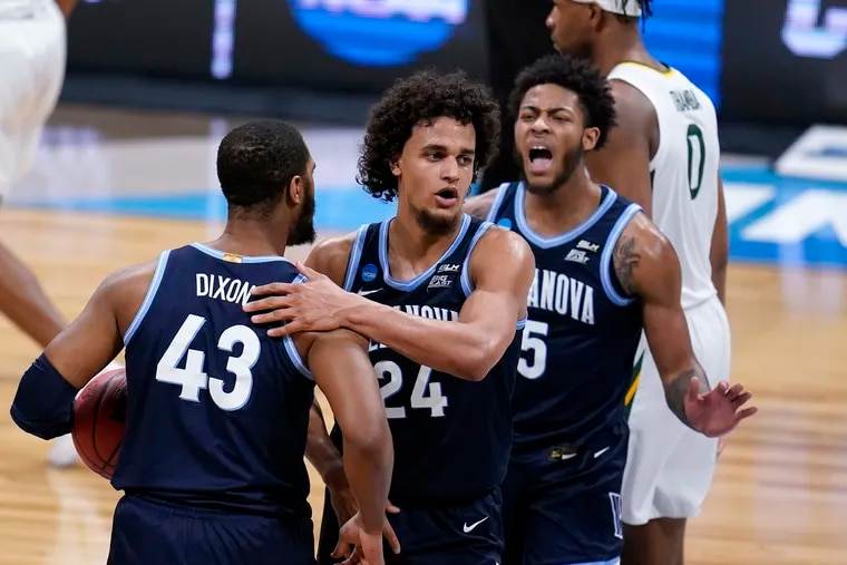 Villanova forward Jeremiah Robinson-Earl (24) celebrates a play with teammates Eric Dixon (43) and Justin Moore (5) in the first half of the Wildcats' Sweet 16 loss to Baylor on Saturday. With the season over, Robinson-Earl now has an NBA decision to weigh.