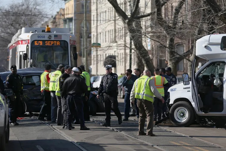 Officials investigate a crash that involved an SUV, a paratransit bus and a SEPTA trolley at South 41st Street and Chester Avenue in West Philadelphia on Tuesday, Feb. 5, 2019.