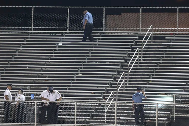 Police check the bleachers after two people were hurt in gunfire at the Marcus Foster Memorial Stadium in the Nicetown-Tioga neighborhood while Simon Gratz was playing Imhotep in a football game Friday night,  September 20, 2019. Acting Police Commissioner Christine Coulter is in the lower left second from the left.