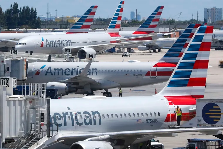 American Airlines aircraft are shown parked at their gates at Miami International Airport in April.