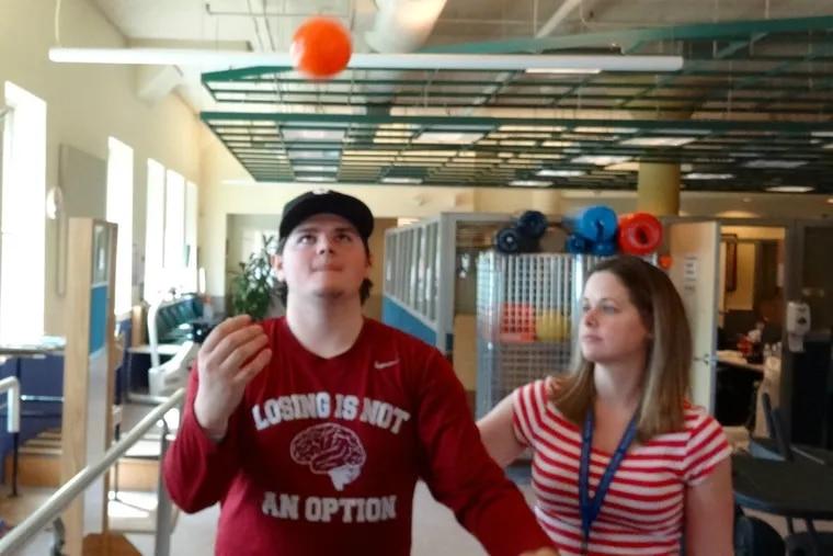 Joey Gorman with Amanda Laarz, senior physical therapist at Magee Rehabilitation Hospital.