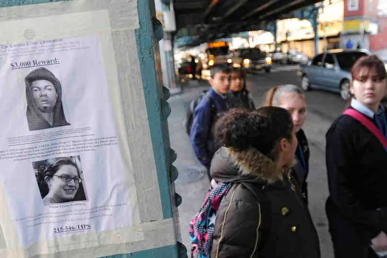 Reward posters can be seen by pedestrians on Kensington Avenue in the effort to solve attacks.