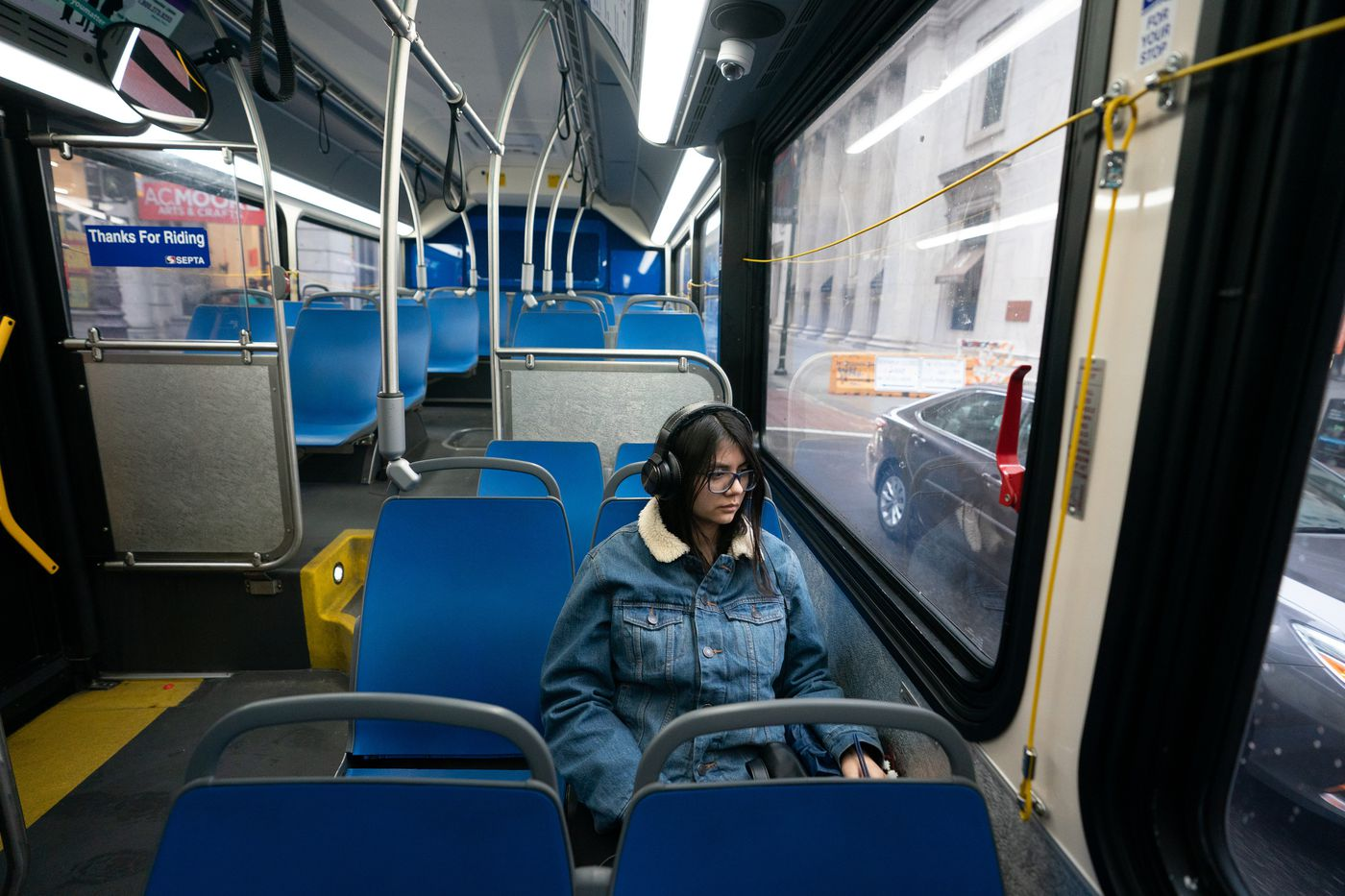 Deanna Garrido rides on a nearly empty bus down Chestnut Street on her way to work, in Philadelphia, March 17, 2020. The coronavirus has been spreading across the globe since January, and now has been identified in the Philadelphia region.