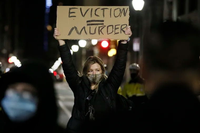 """Veronica Carden, of Philadelphia, faced police as she took a stand in the middle of Walnut Street when advocates for the homeless created an encampment outside the Holiday Inn at 1305 Walnut St. on Dec. 10. Residents at the Holiday Inn, the city's """"Quarantine Hotel"""" and COVID-19 prevention hotel, received notices from the City of Philadelphia Office of Homeless Services declaring an eviction date of Dec. 15 for all residents. Thousands of Pennsylvanians are staring down the possibility of eviction amid the pandemic."""