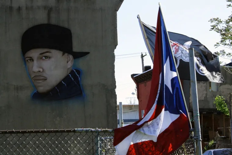 A researcher who lived in Kensington for six years took a photo of a mural commemorating Julio Cesar Augustine who was shot and killed in March 2010 when he was only 21 years old.