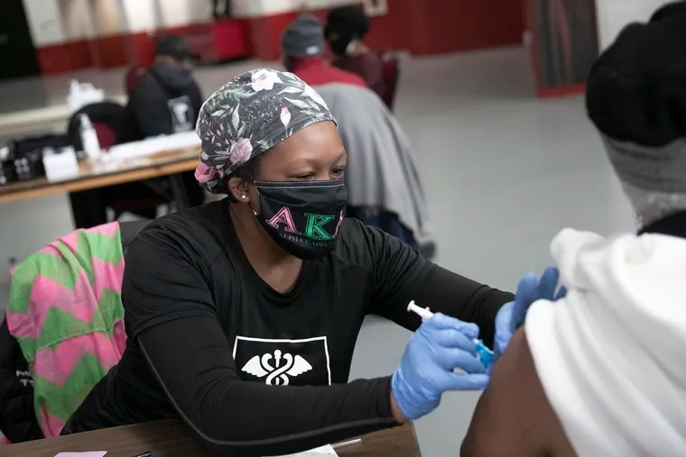 Dr. Faith Peterson administers a COVID-19 vaccine to a patient inside the Liacouras Center on Tuesday. The Black Doctors COVID-19 Consortium has been vaccinating Philadelphia residents.